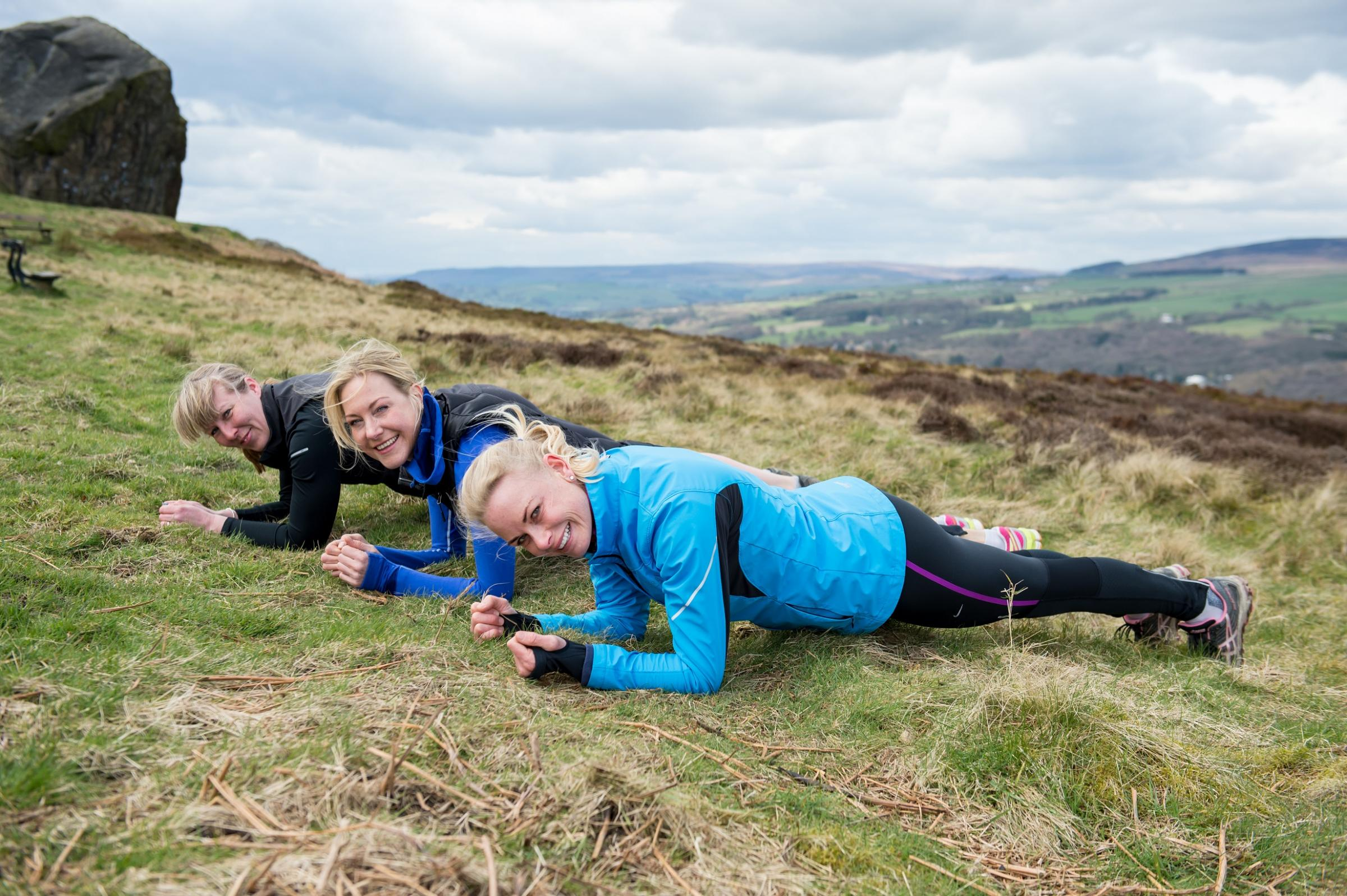 Planking on the Moor are (from left) Sarah Mayrick, Tanya Lindop and Chantelle Scargill