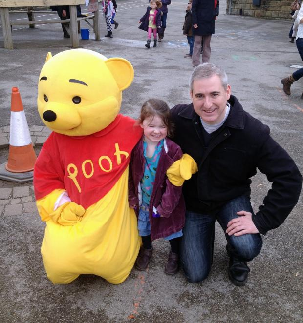 Ilkley Gazette: MP Greg Mulholland and his three-year-old daughter, Ava, met Winnie the Pooh at Westgate Primary School's Easter Fair