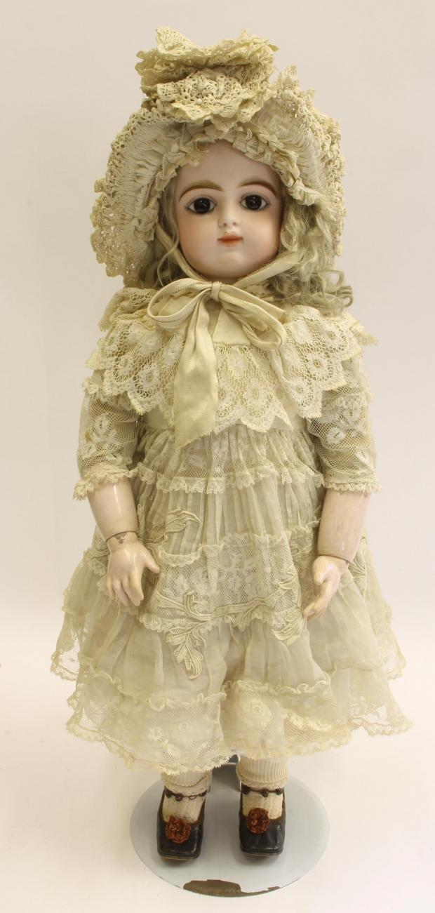 Ilkley Gazette: A Gaultier bisque doll, which sold for £2,400