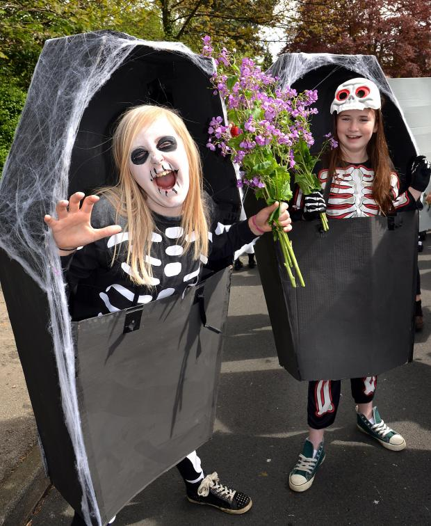 Ilkley Gazette: Lily Bobson (left) and Hope Throp, both 11, from Ben Rhydding Primary School enjoy dressing up for Ilkley Carnival 2014