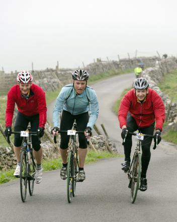 Dave Pringle, Jeremy Nolan and Matthew Thompson ascending a climb at Malham
