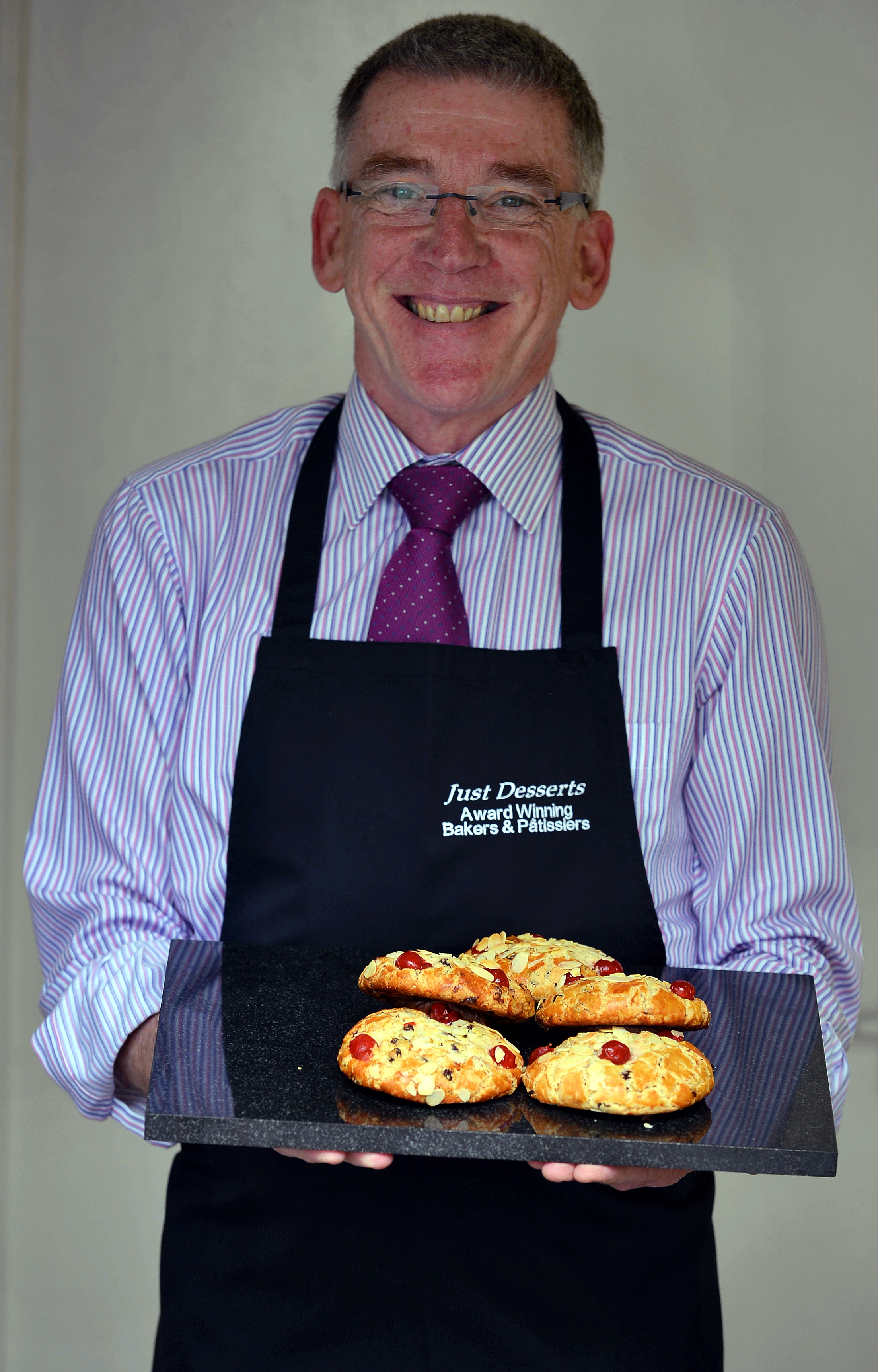 Baker James O'Dwyer with his own version of the scones that caused controversy over its name