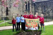 Planting poppy seeds are St Oswald's Junior School pupils (from the left) Ruby Myers, Jack Higgins, Adam Sands, Andrew Haywood, Josh Cousins, Skye Moore, Tom Linney and Skyela Sykes