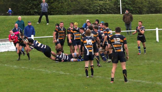 James Falgate dives over the line for the bonus-point try