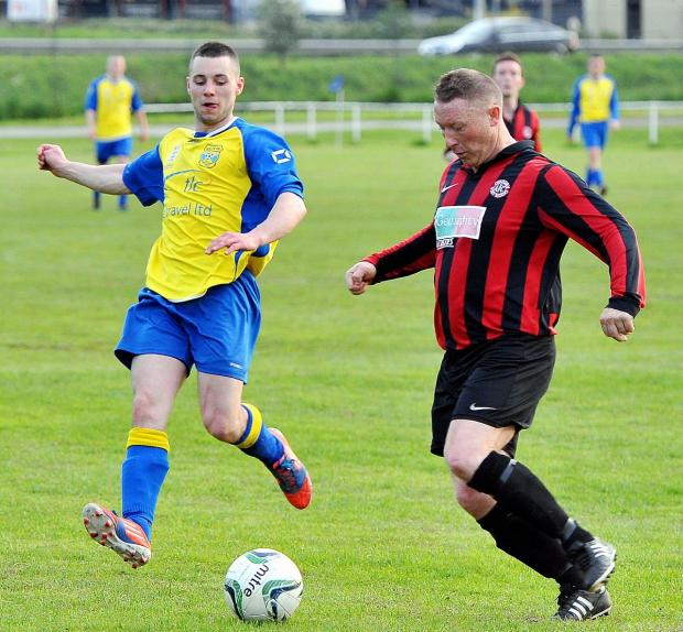 Ilkley Gazette: Salts' Kyle Berry puts Ovenden West Riding's Kevin Megson under pressure during their Premier Division Cup quarter-final