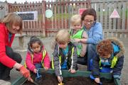 Guiseley children sow poppy seeds for the fallen