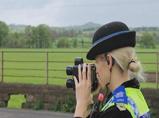 Ilkley Gazette: PCSO Rachael Nicklin monitoring traffic speed as part of a day of police action in Arthington