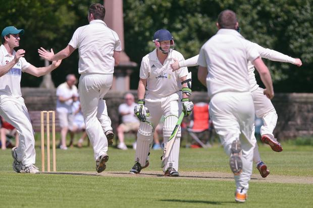 Ilkley Gazette: Otley players celebrate after James Wilcox trapped David Pennett of Ilkley lbw for a golden duck