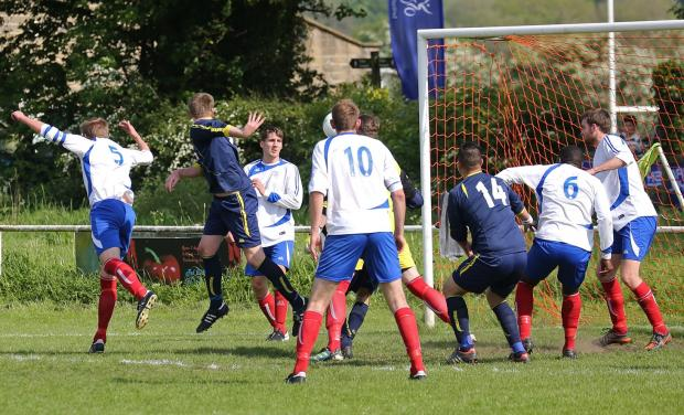 James Wilson heads Ilkley's goal against Pool. Picture: Alex Daniel Photography
