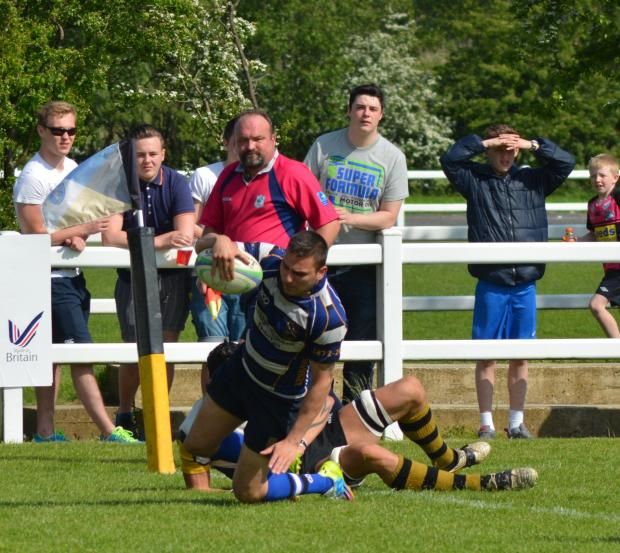 Ilkley Gazette: Alex Clark scores the try which gave Yarnbury the lead Picture: Mick Pound
