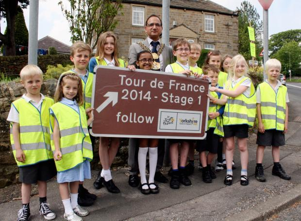 The Lord Mayor of Bradford, Councillor Khadim Hussain Addingham youngsters and one of the new signs