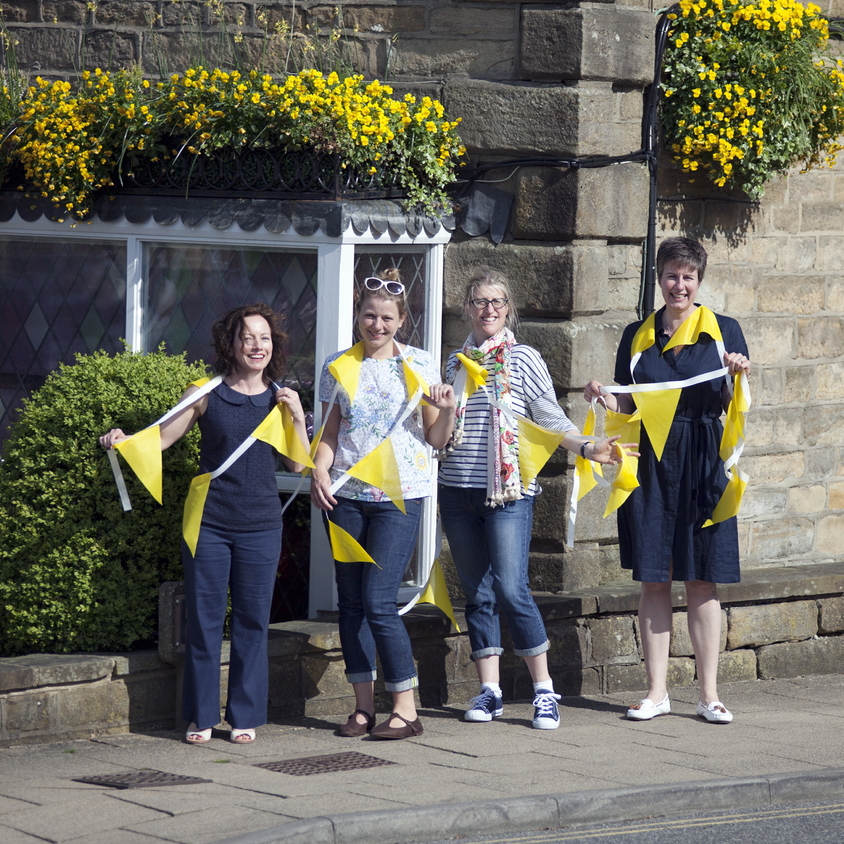 Emma Garry, from Eme Cloth & Yarn, Jenni Smith, of Sew with the Flow, Caroline Grice Ellis, of  Ashlands Makes and Leonie Pratt, of The Sewing Shed, with the Tour de France bunting
