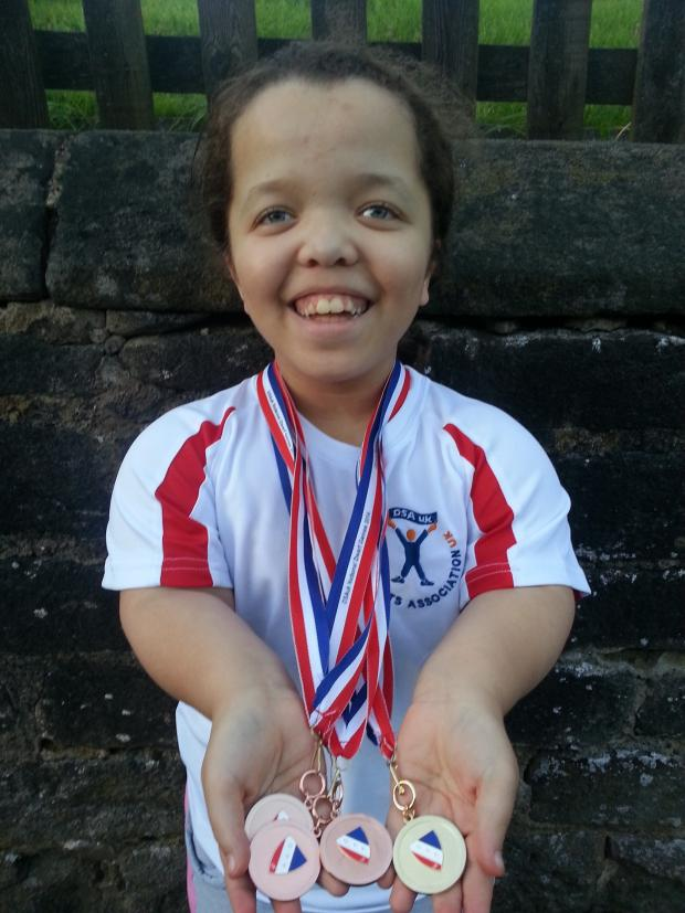 Ilkley Gazette: Savannah Troughton-Webb proudly displaying her medals