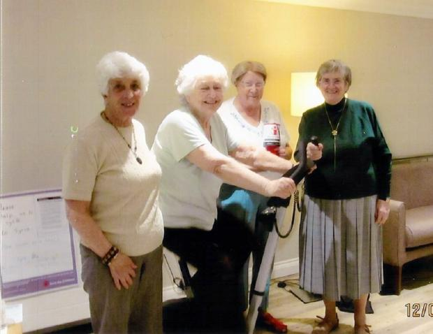 Peggy Appleyard (on exercise bike) with other volunteers who helped raise money for the cause