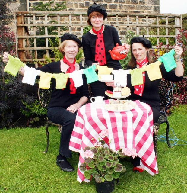 Ilkley Gazette: Entering into the spirit of things ahead of the Tour De France charity afternoon tea at Crown Cottage Farm are, from the left, Diane Elphinstone (Crooklands Farm B&B, Clapham), host Liz Gudgeon and Lisa Preston (Pickersgill Manor Farm)