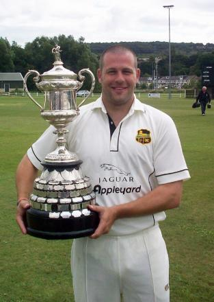 James Smith with the Sovereign Health Care Priestley Cup when Pudsey St Lawrence last won in 2011