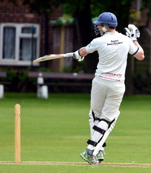 Ilkley Gazette: Pudsey St Lawrence opener Adam Waite gets turned around during his fine knock of 68 against Pudsey Congs