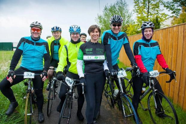 Ilkley Gazette: Acorn chairman Louise Hanen with the first group of cyclists on the charity ride