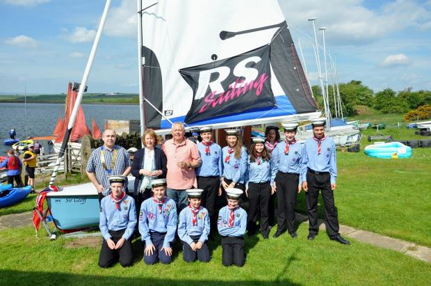 Wharfedale Sailing Scouts celebrate receiving their new boat at the naming ceremony. Among others they were joined by Lester Mulligan and Geoffrey Vere's daughter Annabelle