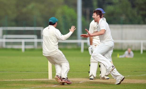 Ilkley Gazette: TOP DOGS: James Wilcock celebrates a wicket for Otley – the only unbeaten team in Division One – against Ben Rhydding