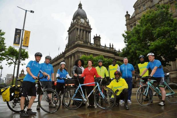 (6777202) Leeds City Council executive member for leisure and skills Cllr Lucinda Yeadon (centre) with centre left Heather Nelson chief executive of Black Health Initiative together with British Cycling ride leaders and members of City Riderz