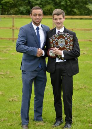 (6848781)Tom Taiwo present St Mary's student, Francis Westhead, with his award