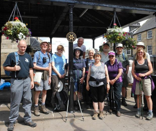 Ilkley Gazette: Walkers gathering at The Buttercross, the starting point of the Six Dales Trail, during the 2013 Otley Walking Festival.