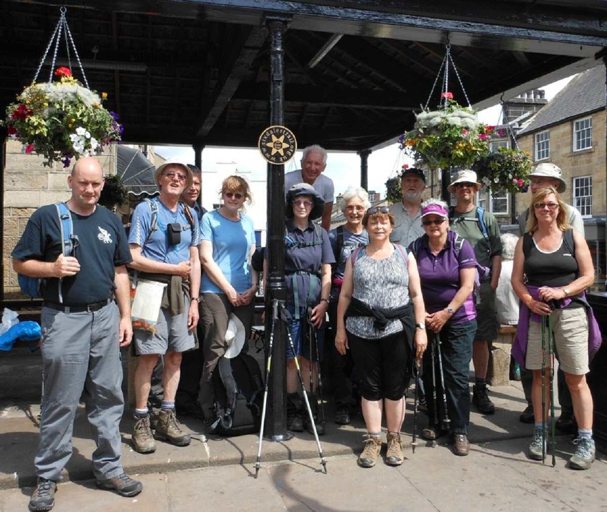 Walkers gathering at The Buttercross, the starting point of the Six Dales Trail, during the 2013 Otley Walking Festival.