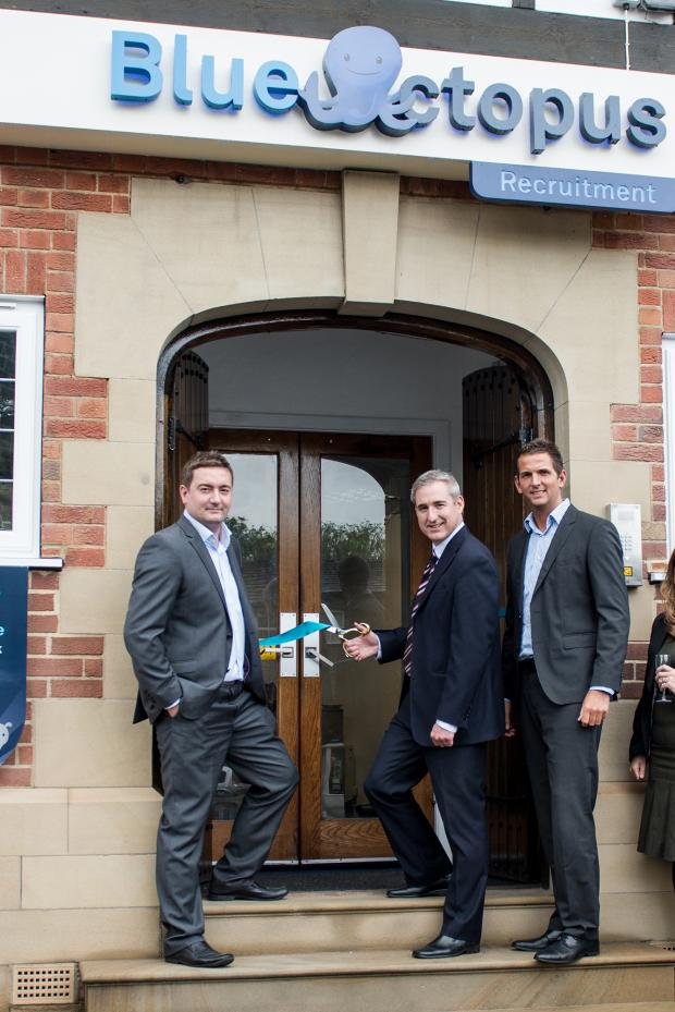 Ilkley Gazette: MP Greg Mulholland, flanked by the co-founders and joint managing directors Chris Coleman (left) and Liam Coleman (right), opening Blue Octopus's new Otley base.PHOTOGRAPHY BY JBCREATIVES.CO.UK