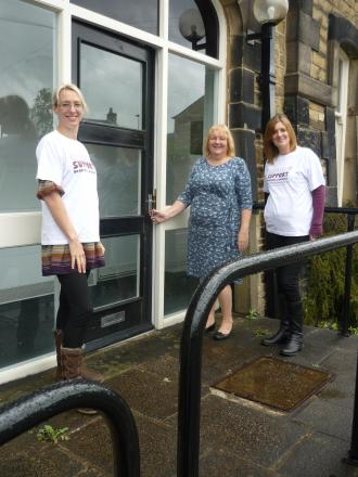From left to right :- Rachel Taylor, Linda Howard (director) and Lisa Wade from the wellbeing team outside the door of the new Skipton Satellite on Otley Street