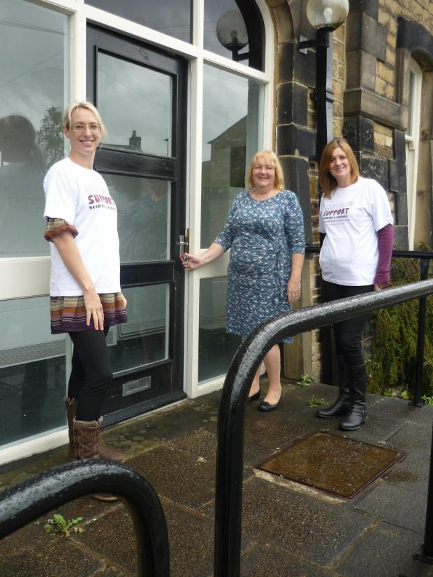 Ilkley Gazette: From left to right :- Rachel Taylor, Linda Howard (director) and Lisa Wade from the wellbeing team outside the door of the new Skipton Satellite on Otley Street