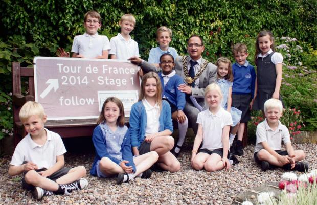 Please find attached some pictures of the TdF signs in Addingham picture of kids with hi-vis jackets: L-R -  Kian, Annie, Alex, Freya, Nishita, James, Thomas, Prada, Arianwen, William, Fiona and Findlay.   (7218507)