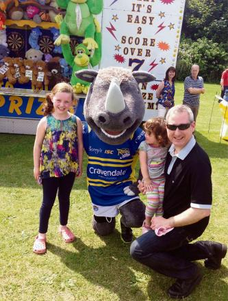 submitted pix: MP Greg Mulholland at Yeadon Carnival two of his daughters Isabel (7) and Ava (2) and Ronnie the Rhino.    (7413775)