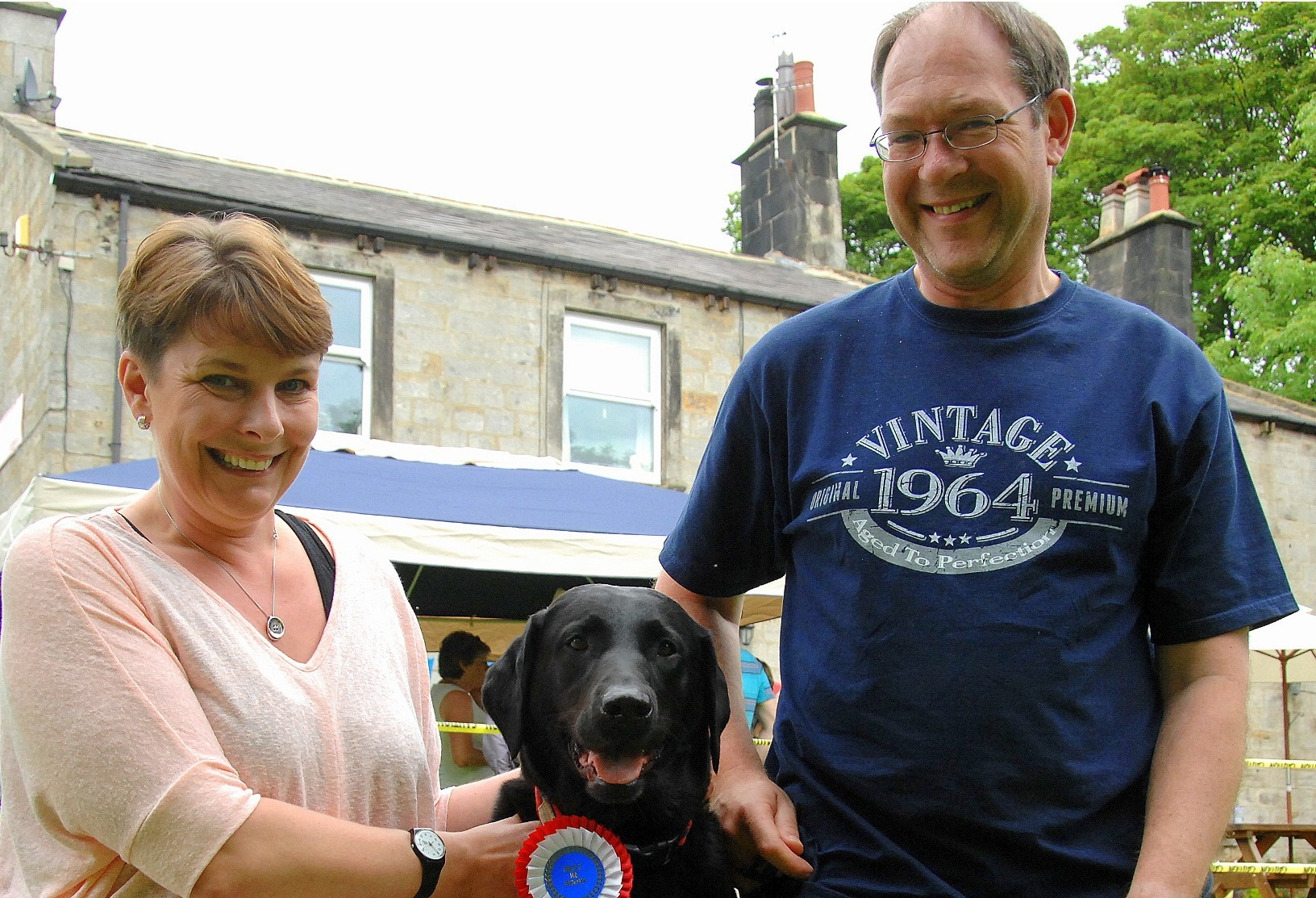Cock Pit Farm Tea Rooms' owner Sue Sansbury with 'best in show' winner Max, a veteran rescue Labrador, and his owner Paul.