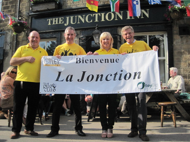 Tony and Melanie Grey,  the landlord and landlady of The Junction Inn accepting their French banner. Left to right: Tony Greg, MP Greg Mulholland, Melanie Grey, and Otley Pub Club committee member Andrew McKeon.
