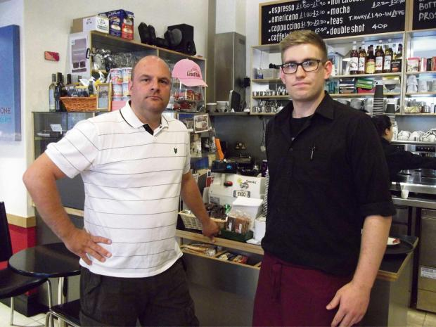 from left: Stuart Tolch, a regular customer at La Stazione in Ilkley, with the cafe's manager Max Crane, at the counter where the charity box was stolen from