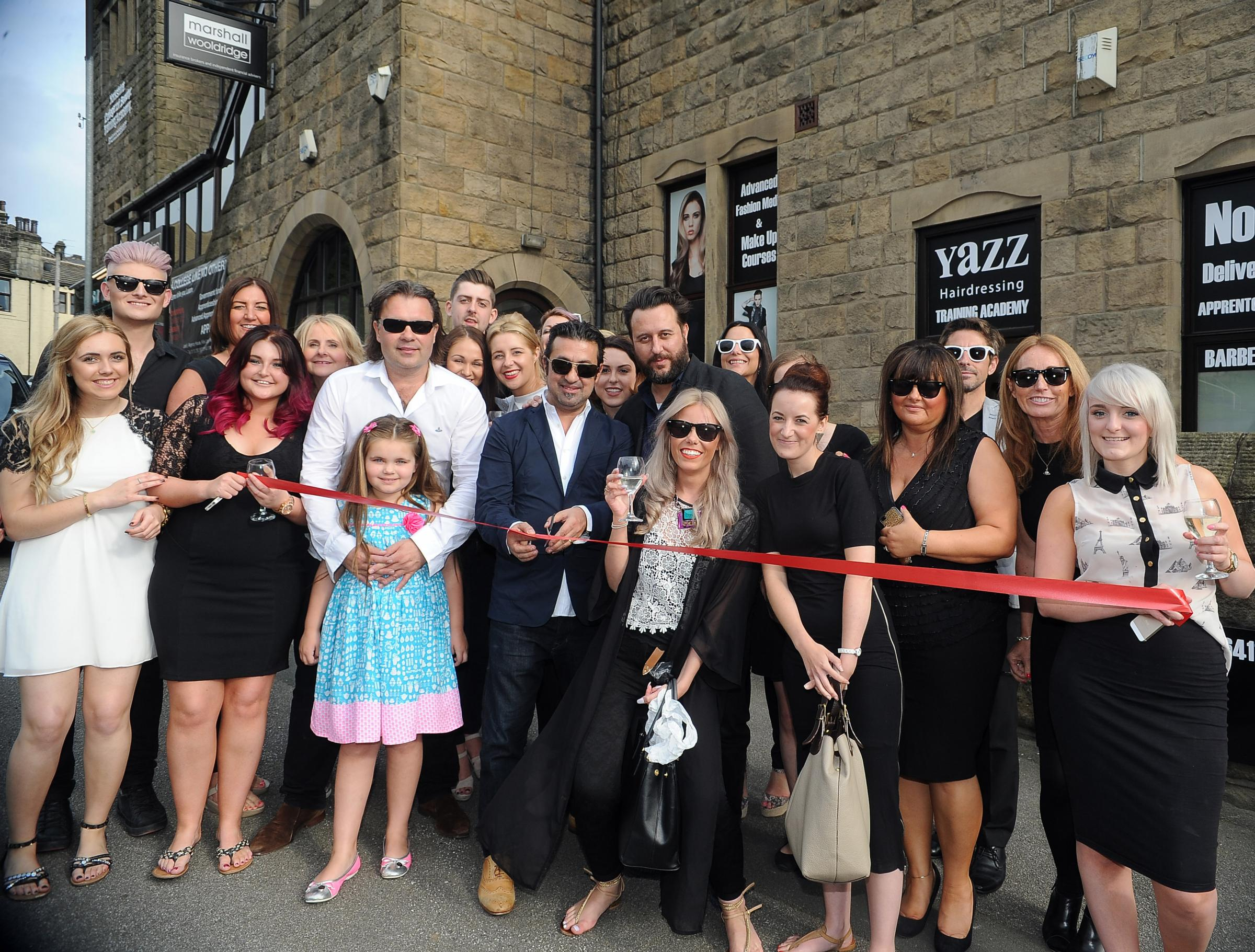 Salon owner Paul Shakeshaft (third from the left, front row) at the opening of his new academy