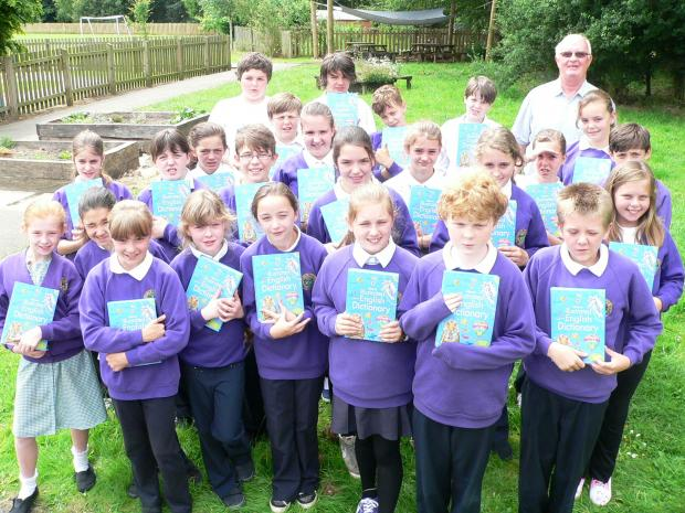 Year 6 pupils at Ashfield Primary School, Otley, with their new dictionaries and the Rotary Club of Otley Chevin's community service chairman, Roy Tate.