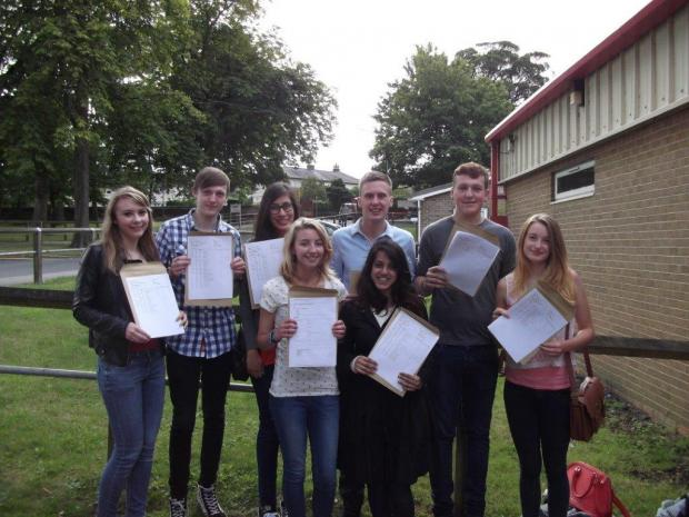 Students at Rawdon's Benton Park School celebrate their A-level results: Olivia Crispin, Cameran Pullan, Liam Cook-Monie, Lauren Bonde, Miles Jordan, Tom Barker, Aneeqa Ahmed and Megan Harris
