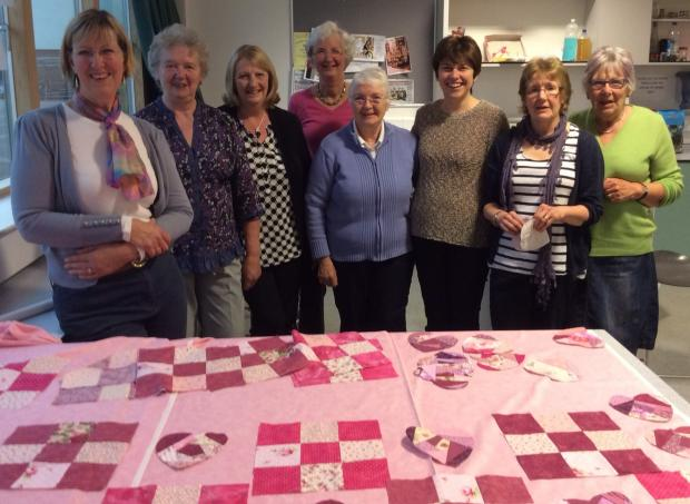 Otley quilters with their heart-themed, fundraising creation.
