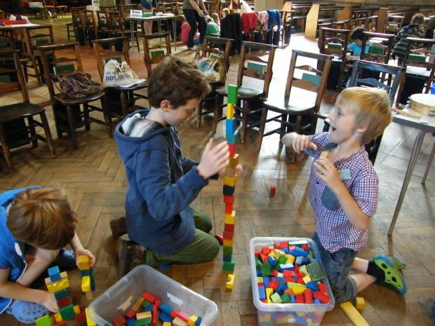 (9156071)Two boys enjoy building a tower block higher and higher as part of the theme of the Mega Makers holiday club in Ilkley.