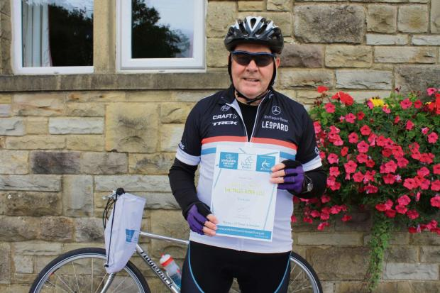Adrian Cox with his certificate at the end of last year's Dales Rider challenge