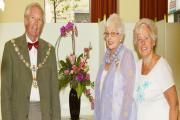 (9911301)Ilkley Parish Council chairman, Andrew Walbank, with Heather Chapman and Sheila Morgan of Ilkley Flower Show Society, and one of the exhibits at the show