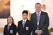 New head teacher of St Mary's, Menston, Darren Beardsley, with two of his students