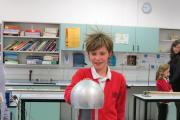 Elsa Beese, a Year 6 pupil from Bramhope Primary School, enjoys a hair-raising science experiment at Prince Henry's Grammar School's open evening.