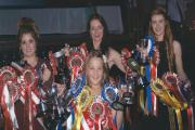 Rebecca Sharp, Tracey Bastow, Michelle Latham and in front Katie Smith, with their championship trophies and rosettes
