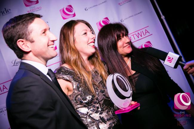 From the left, Andrew Pratt, general manager; Michelle Hudson, events manager, and Rena Gueller of The Box Tree accept The Wedding Industry Award for 2015 National Award for Best Events Team