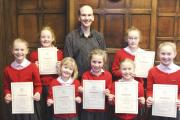 (18276303) Moorfield School choirmaster and singing teacher, Steve Bradnum, with Emily Hoeg, Grace McIntosh, Imogen McIntosh ,India Burns, Sofia Hoeg, Amy Gott and Sanna Hoeg