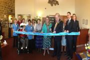 The Lord Mayor of Bradford, Councillor Mike Gibbons, cuts the ribbon to celebrate the completion of a £300,000 refurbishment at Burley Hall Nursing Home.