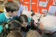 Otley Amateur Radio Society member Kevin Gallagher letting pupils at Ashfield Primary School 'listen in'.